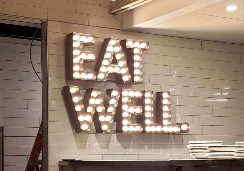 Palasad Interior Light Bulb Channel Letters - Installation by Why Design