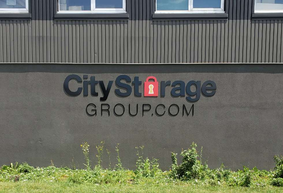 Aluminum Dimensional Lettering For City Centre Storage by Why Design